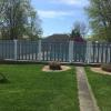 5' high Kingston pool fence with 3' gate. Fencing gray with white post and caps